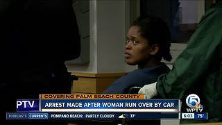 Arrest made after woman run over by car