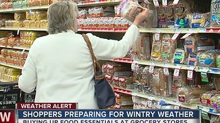 Rush to stock up on food as winter storm nears - Video