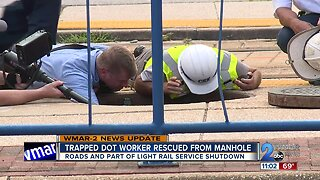 Trapped DOT worker rescued from manhole