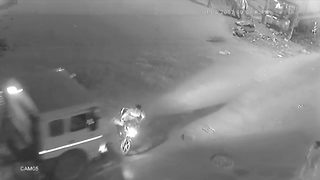 Biker escapes unhurt after speedy truck drags him for almost six-metres - Video