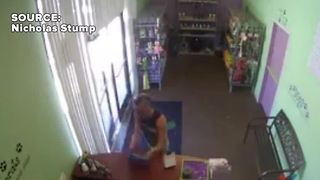Man takes tablet from pet store - Video