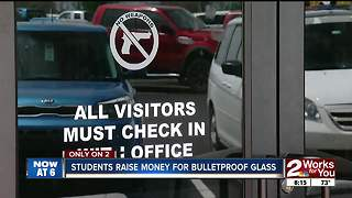 Students raise funds for bulletproof glass - Video