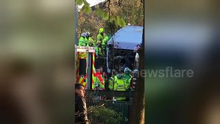 Eighteen injured, one critically, after bus mounts Glasgow embankment - Video