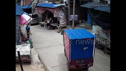 Three-wheeler started up by 9-year-old girl crashes into stall, tips over and flattens boy