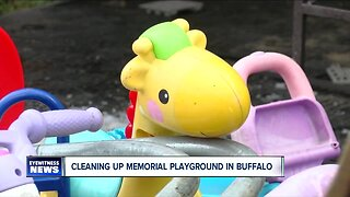 Helping clean up after vandals hit a playground