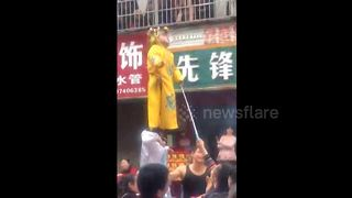 Boy nods off during festival performance - Video