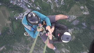 Thrill-seeking couple go on BASE jumping date - Video