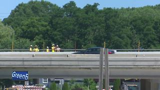 Excavator tips onto Interstate-41 in Suamico