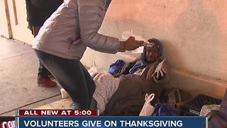 Volunteers give to the homeless on Thanksgiving