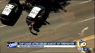 CHP chase starts after car nearly hits firefighter - Video