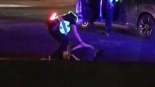Tempe officer seen dragging handcuffed woman on video - Video