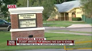Student arrested for bringing fake gun to school, holding it to another student's throat - Video