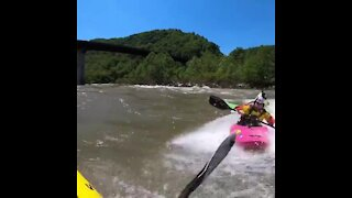 Crazy kayaker performs some epic stunts