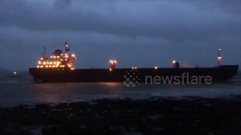 Russian cargo ship stranded on UK beach during low tide