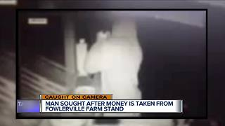 Man caught on video stealing money from roadside farm stand in Fowlerville