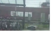 Glass Panels Smash Onto Ground Outside Train Station During Netherlands Storm - Video