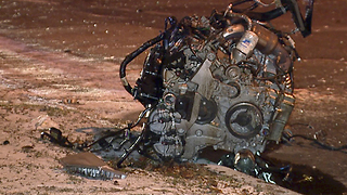 Engine torn out after a driver hits a tree, pole and parked car in Cleveland - Video