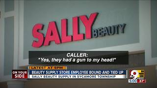 Two men rob Sally Beauty Supply store at gunpoint - Video