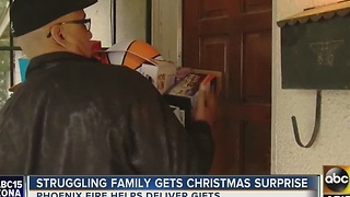 Struggling family gets surprise from Phoenix firefighter - Video