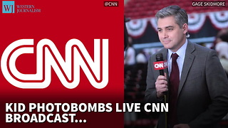Kid Photobombs Live CNN Broadcast, Appears To Shout 'Fake News' - Video
