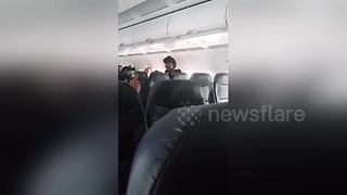 Rude plane passengers get angry as they are not let off the aircraft first - Video