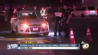 Woman killed by motorcycle while crossing street