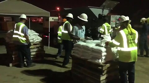 Crews work to fill thousands of sandbags in Tulsa