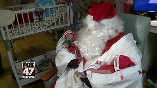 Santa brings holiday cheer to Sparrow's tiniest patients and their siblings - Video
