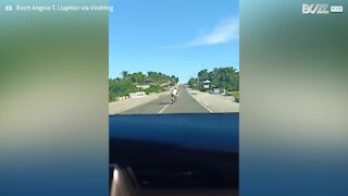 Motorcyclist swerves dangerously all over highway