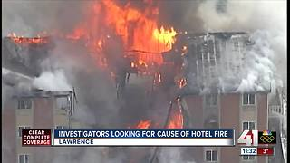 Investigators look for cause of hotel fire - Video