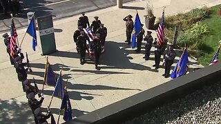 Body of MPD Officer Mark Lentz arrives at Brookfield church for funeral services