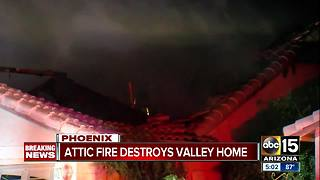 Firefighters rescue dog as house goes up in flames in west Phoenix - Video