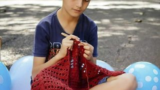 Brazilian boy crocheting up thousands of fans - Video