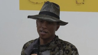 Pharrell Williams celebrates femininity at Paris exhibition - Video
