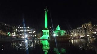 Trafalgar Square lit up green ahead of St Patrick's Day - Video