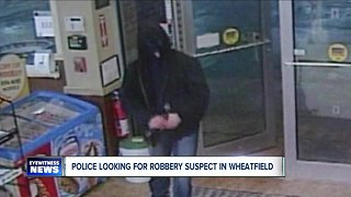 Police search for robbery suspect - Video