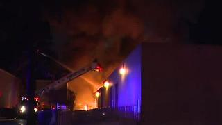 Three alarm fire rips through businesses - Video