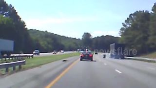 Dash Cam Records Head-On Collision After Loose Tire Flies Across I-75  - Video