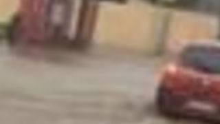 Cars Move Slowly Along Flooded Roads as Cyclone Hits Island of Reunion - Video