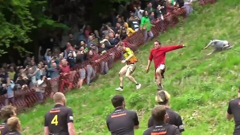 Daredevils Run Down Cooper's Hill For Gloucestershire Cheese Rolling Race In The UK