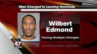 Lansing man charged in connection to murder - Video