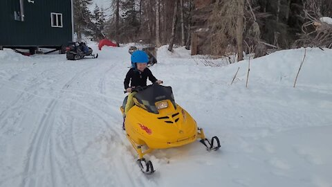 Fearless 4-year-old drives snowmobile for the first time