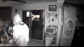 Two burglary suspects caught on surveillance video take items from retired police officer's home - Video