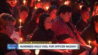 Fallen officer honored by hundreds at vigil - Video