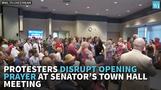 Protesters Disrupt Opening Prayer At Senators Town Hall Meeting - Video