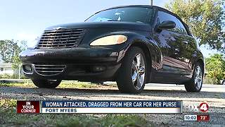 Woman robbed at gun point, then dragged from her car for her purse