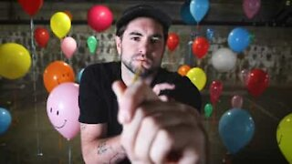 Man covers pop song using helium balloons