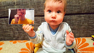 Cute baby eating a carrot with daddy  - Video