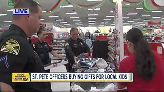 St. Pete police officers take kids in need Christmas shopping - Video