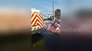 Major UK road closed after lorry crash sends thousands of Coke cans onto road